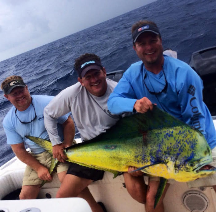 3 men holding a maui they caught