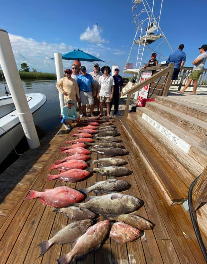 A group with their catches from a fishing trip in Apalachicola