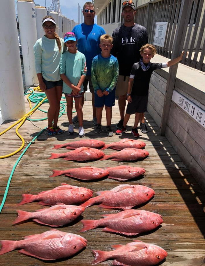 Family with their catches from the fishing charter